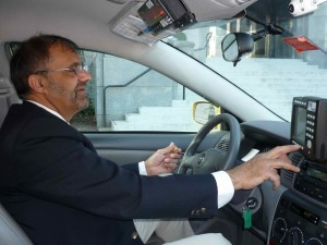 Black Top driver and owner Amrik Mahil looks for a fare.