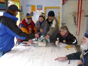 Downtown Eastside residents gather around the table in the Oppenheimer Park field house to map the neighbourhood's assets: (left to right) Fred Popovish, Rocky D, Wendy Pederson, Nick, Jean Swanson and Rudolf.