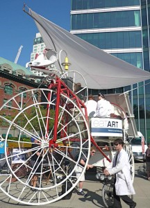 Trikelosaurus? White-coated scientist works over the largest vehicle at yesterday's BEST Commuter Challenge at 200 Granville.