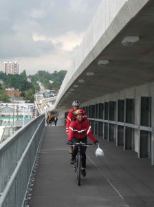 Cyclists head south from Vancouver over the new Canada Line North Arm crossing for cyclists and pedestrians.