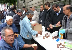 Gregor Robertson, with Haroon Khan, at Ramadan Spirit food distribution.