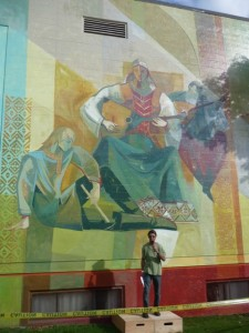 Richard Tetrault in front of the Russian Hall's balalaika woman, just part of the massive mural now transforming the building at 600 Campbell Ave.