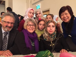 At Jan. 8 welcome banquet for Syrian refugee families with Jan O'Brien, Queenie Choo, of SUCCESS, and five new friends.
